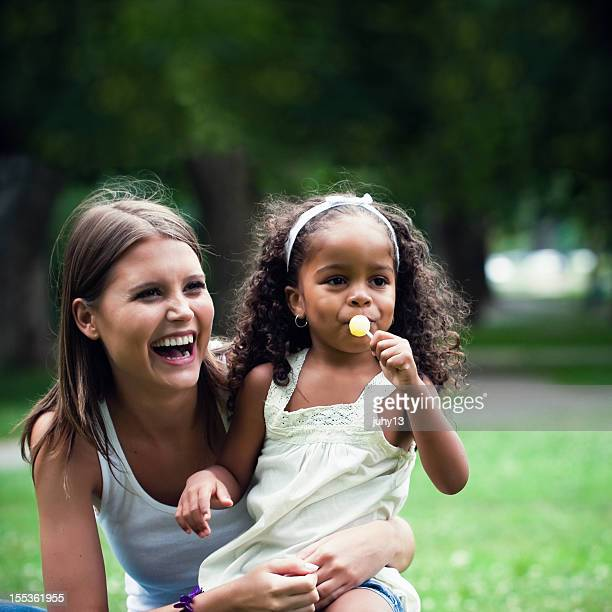 African american child together a white girl in the park