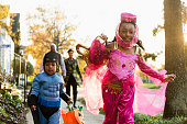 African American children trick-or-treating on Halloween
