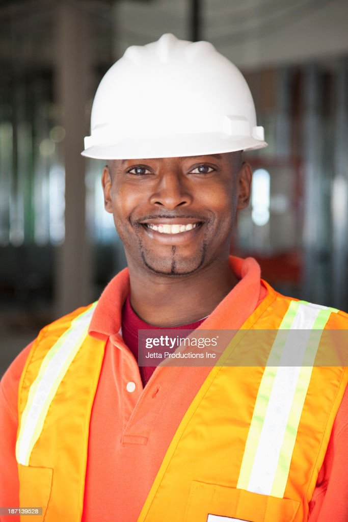 African American construction worker smiling : Stock Photo