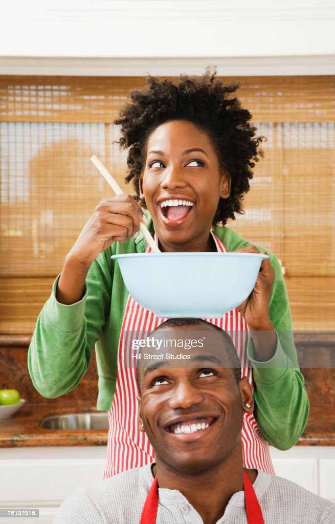 African American couple baking in kitchen : Stock Photo