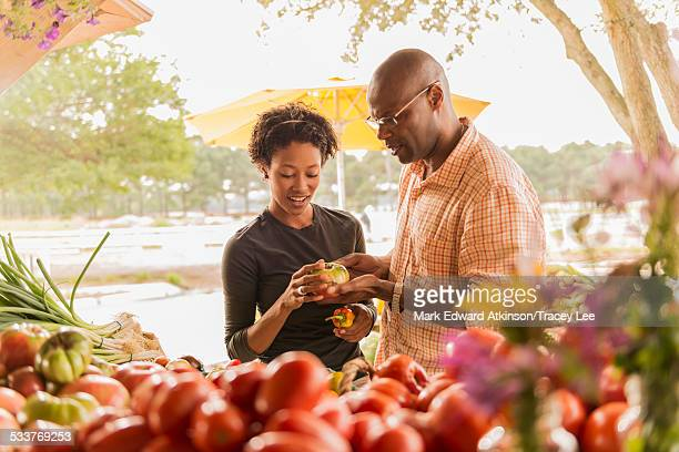 African American couple browsing produce in farmers market