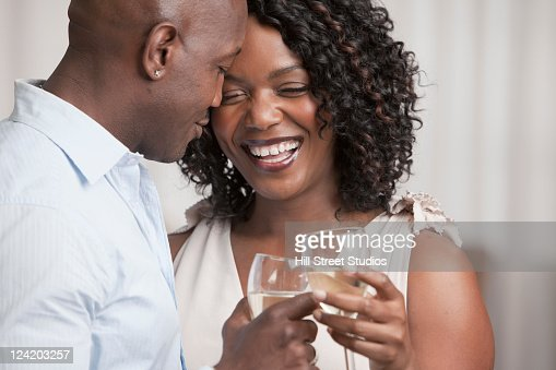 African American couple drinking white wine