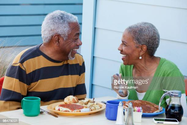 African American couple eating breakfast in cafe