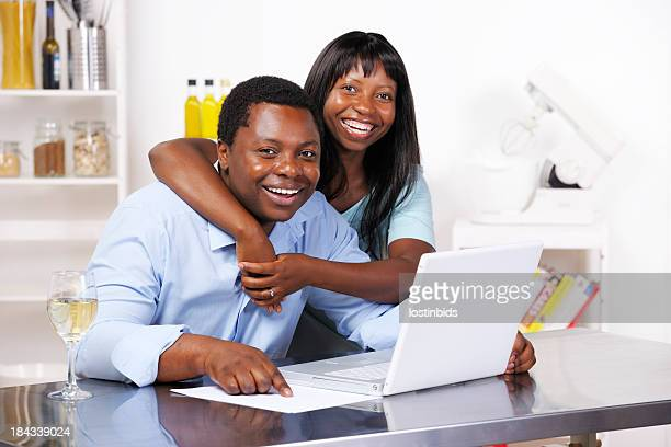 African American Couple Happy About Savings/ Statement