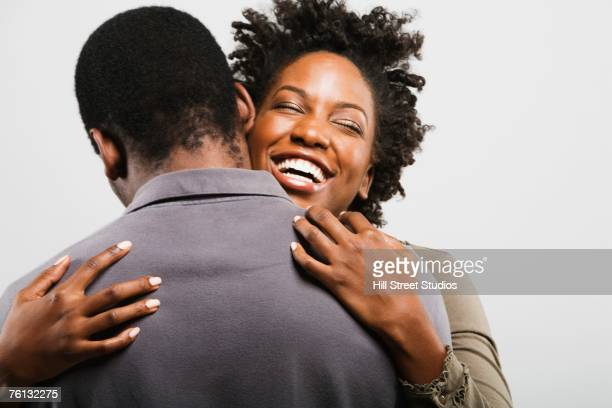 African American couple hugging