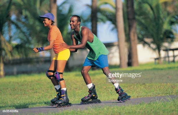 African American couple in-line skating