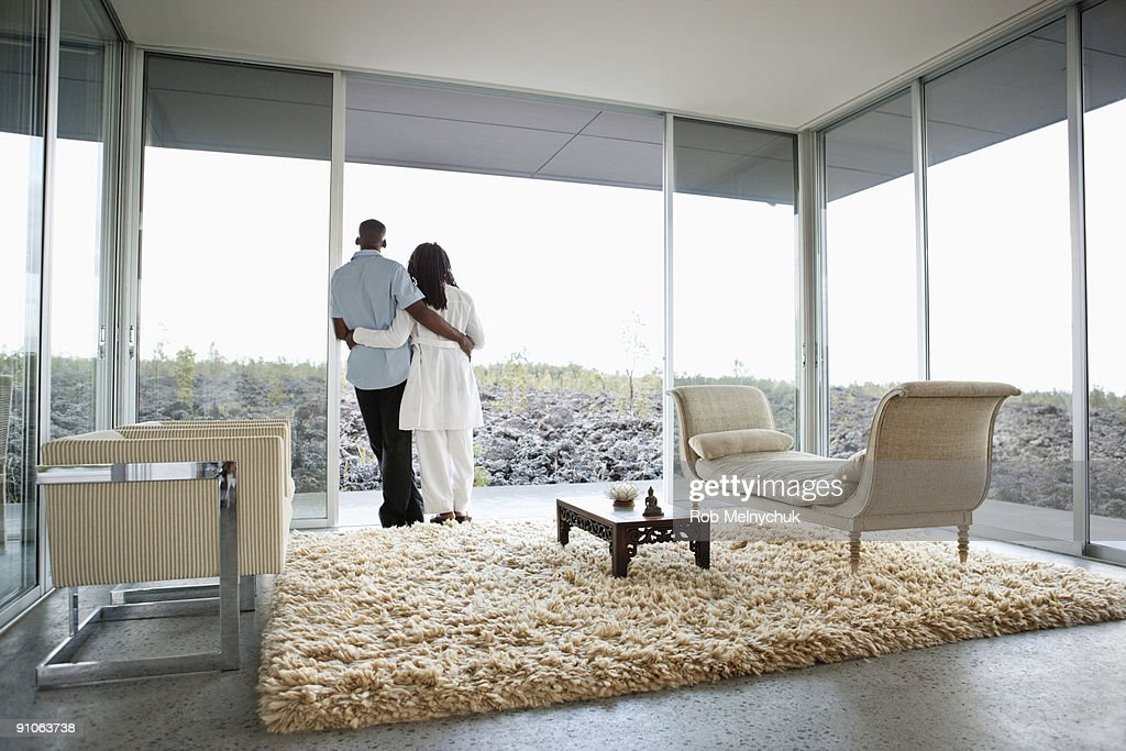 African American couple, looking out at rocks. : Stock Photo