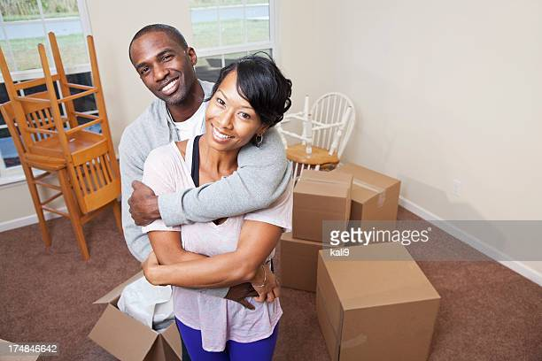 African American couple moving house