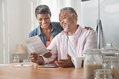 African American couple reading brochure