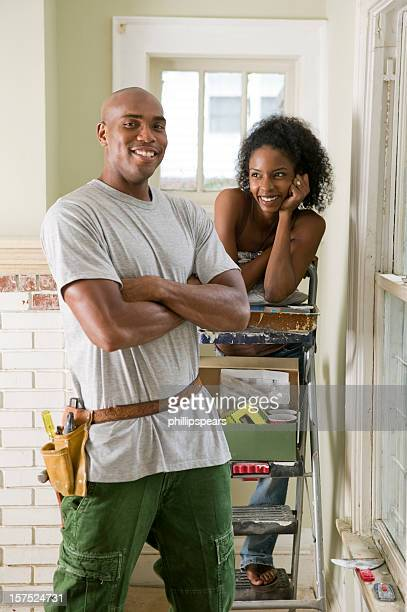 African American Couple renovating their home.