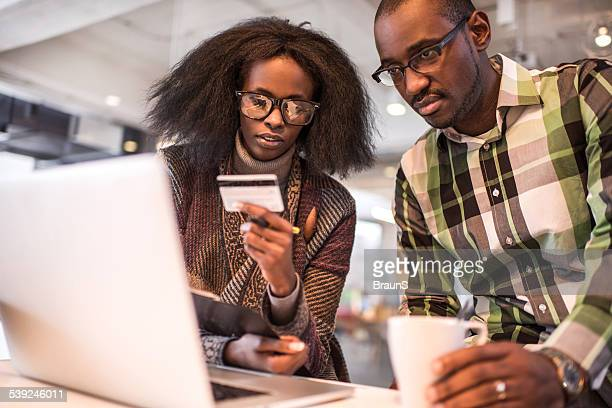 African American couple shopping online.