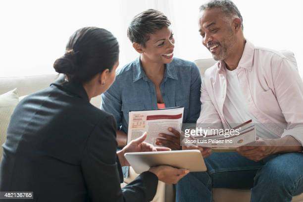 African American couple talking to financial planner