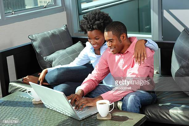 African American Couple Using a Laptop in the Living Room