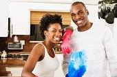 African American couple with cleaning tools