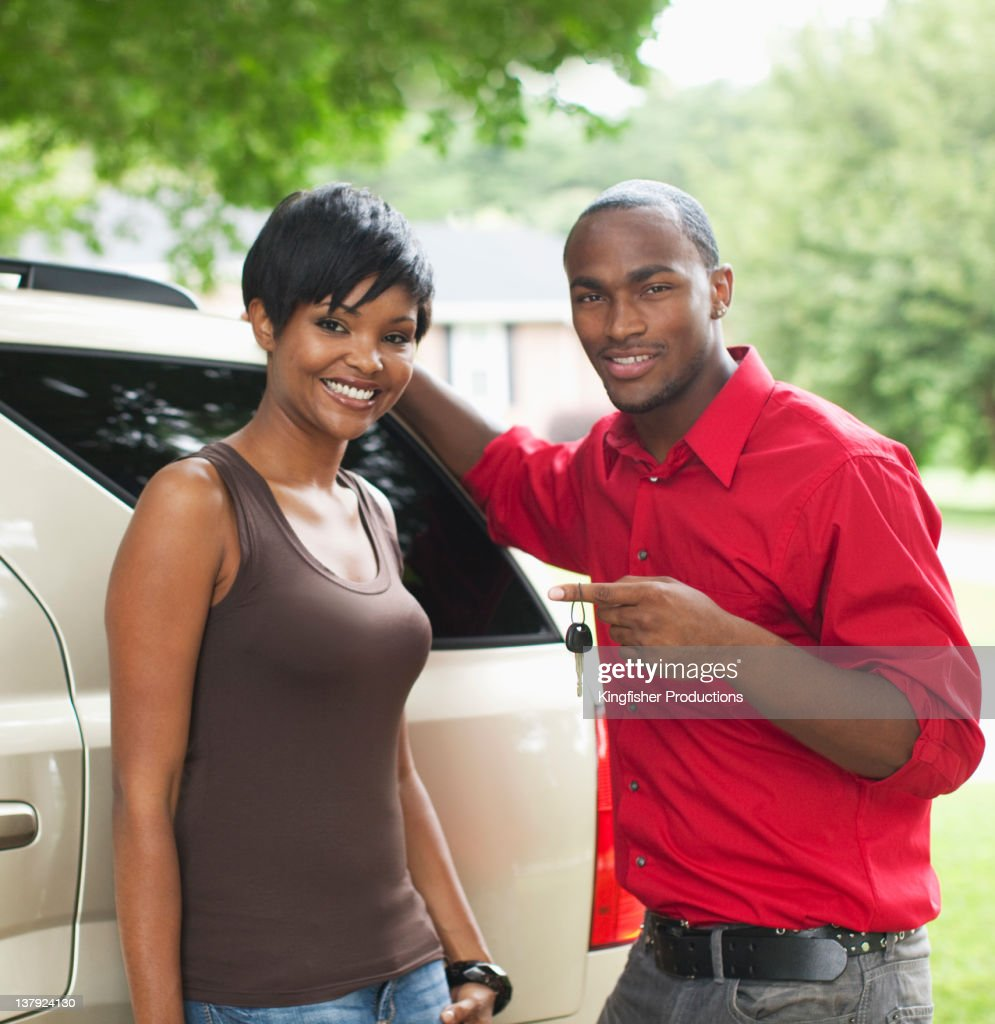 African American couple with new car : Stock Photo