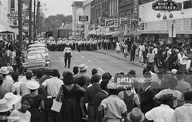 500 African American demonstrators are blocked by police on Farish Street in Jackson Mississippi after a memorial march held for slain Civil Rights...