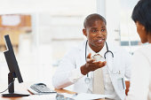 African American doctor communicating with his patient