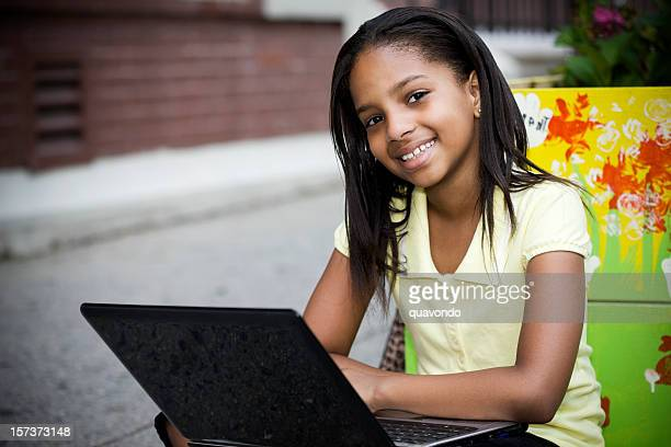 African American Elementary Student Using Laptop Outside, Copy Space