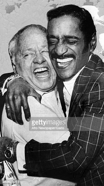 African American entertainer Sammy Davis Junior hugs Mickey Rooney 1970