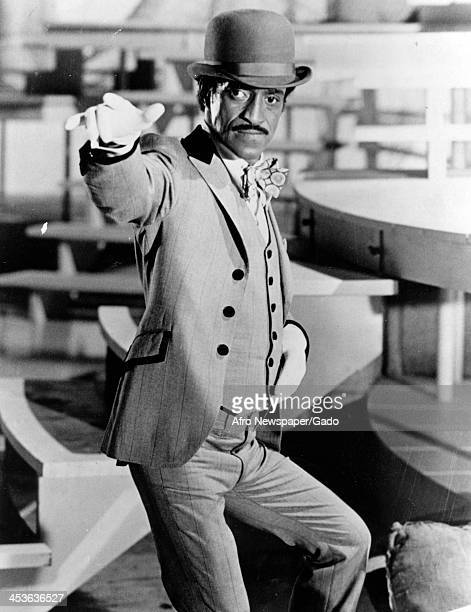 African American entertainer Sammy Davis Junior poses on set with a tophat and white gloves 1970