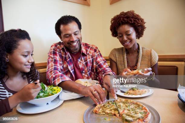 African American family eating in restaurant
