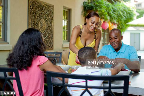 African American family eating lunch on patio