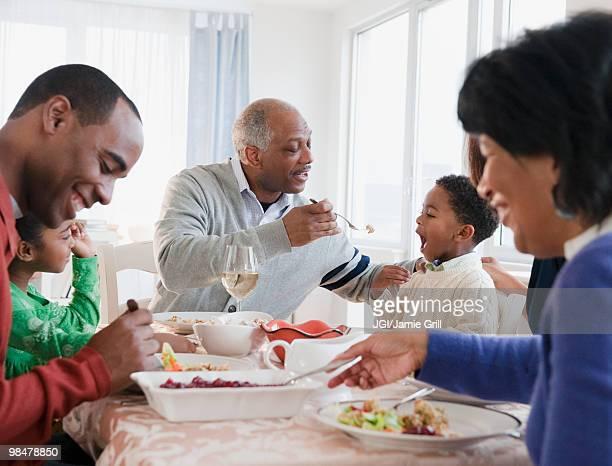 African American family enjoying Thanksgiving dinner