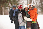 African American family enjoying the snow