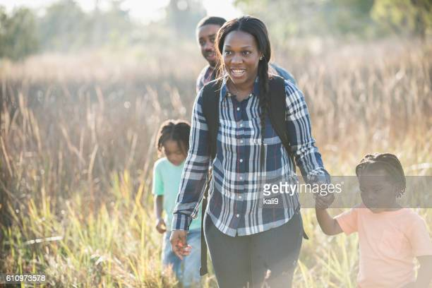 African American family exploring nature