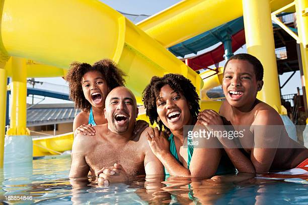 African American family having fun at water park