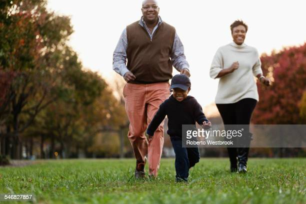 African American family playing in park