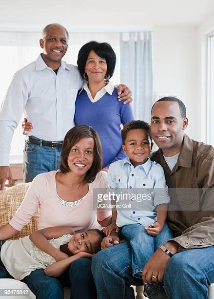African American family sitting in living room