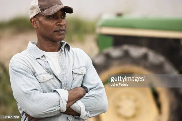 African American farmer with arms crossed