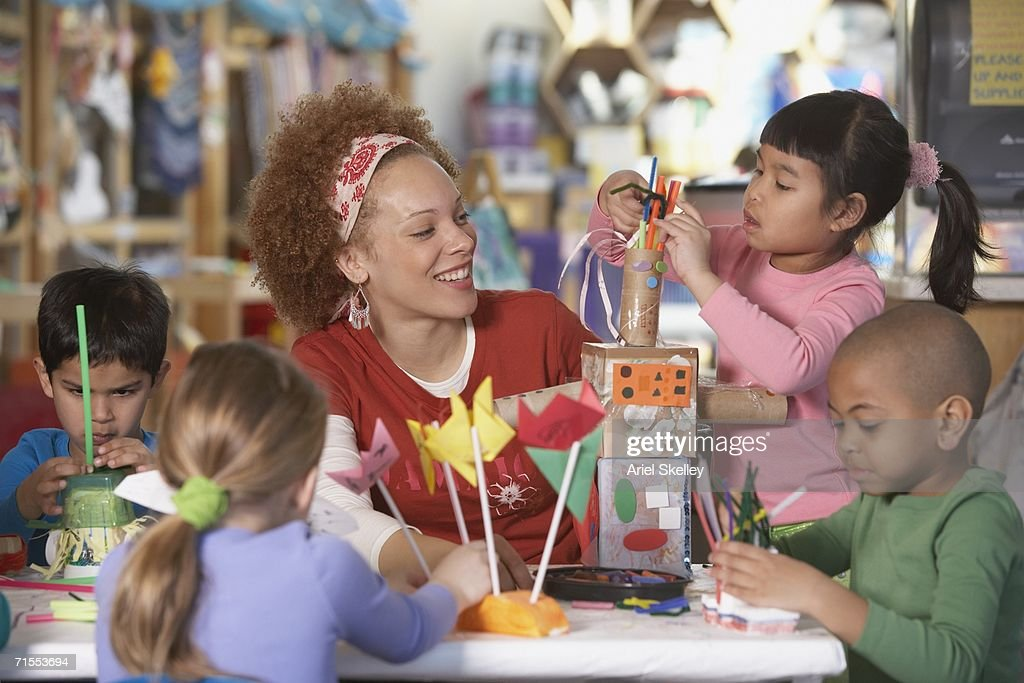 African American female Art teacher with young students