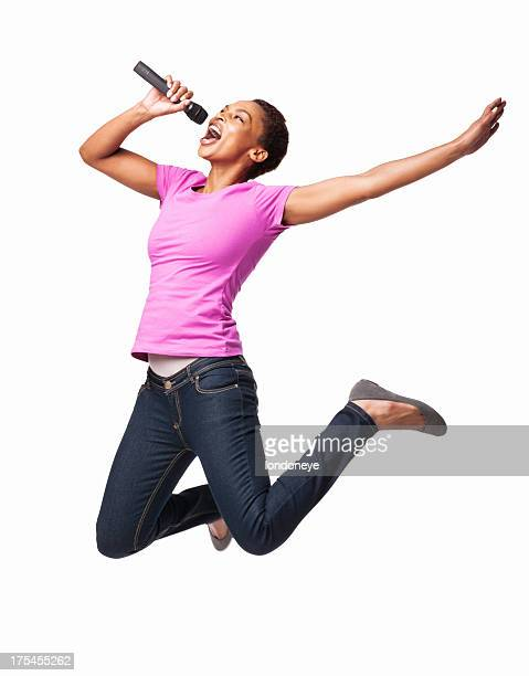 African American Female Jumping While Singing On Mike - Isolated
