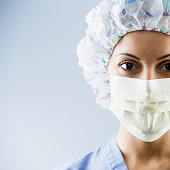 African American female medial professional wearing surgical mask