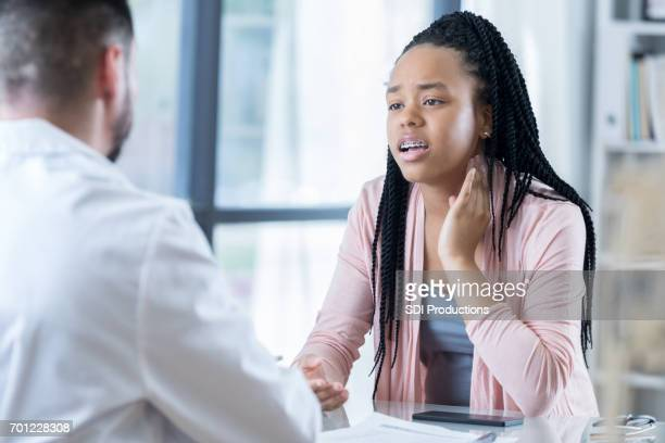 African American female patient talks with doctor about her symptoms