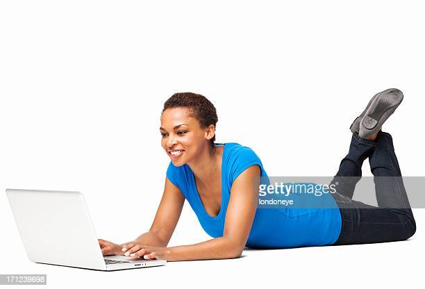 African American Female Using Laptop While Lying On Floor-Isolated