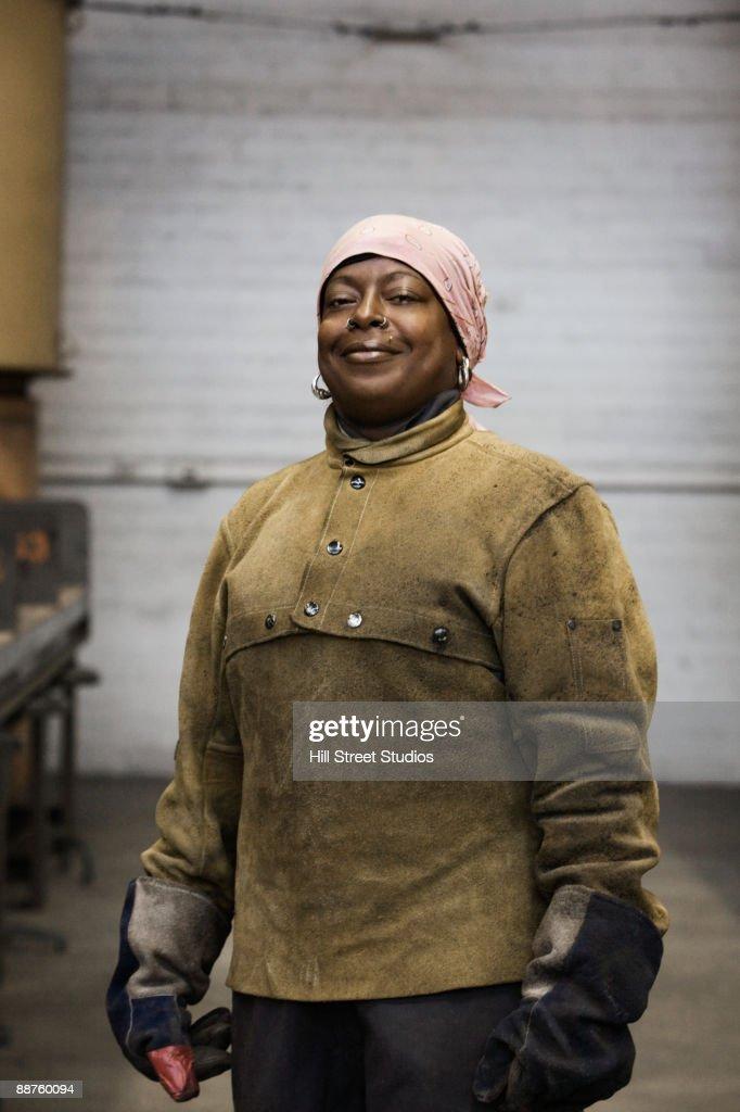 African American female welder posing