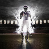 African American football player illuminated on field