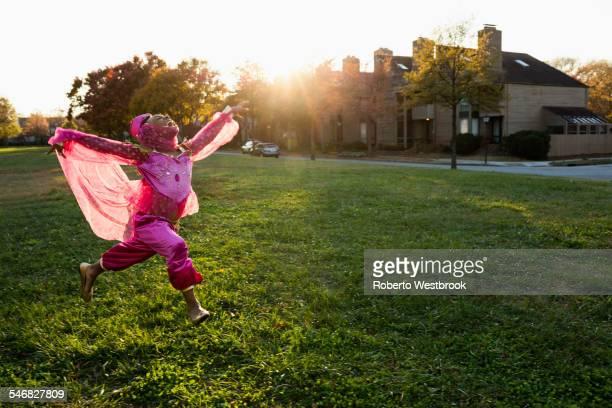 African American girl dancing in princess costume