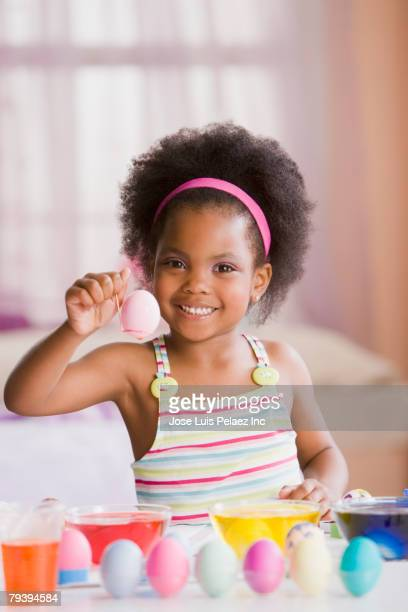 African American girl dying Easter eggs