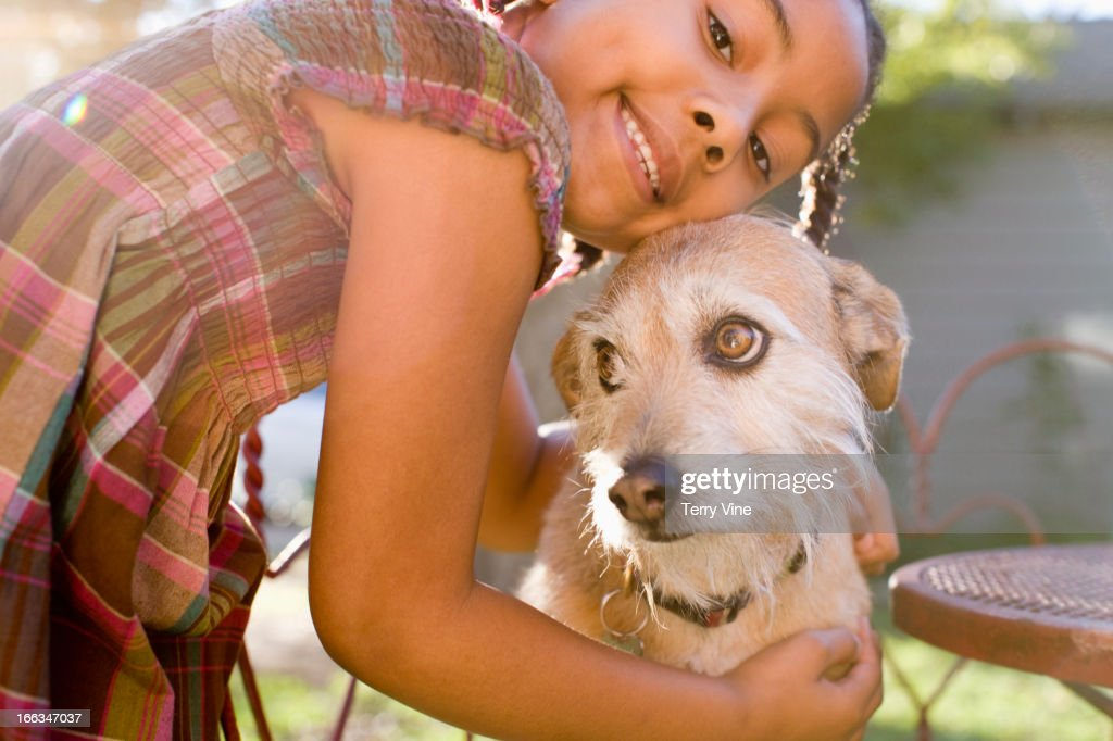 African American girl hugging dog : Stock Photo