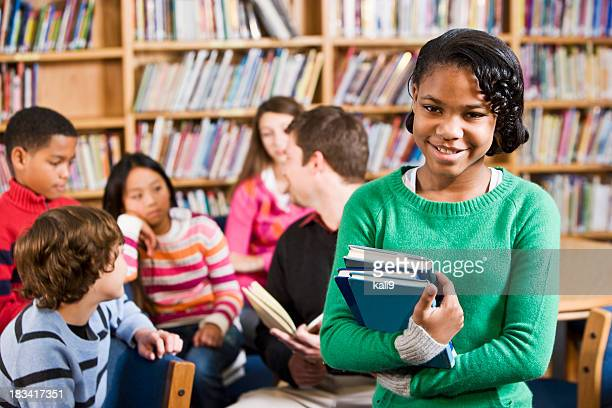 African American girl in school library smiling