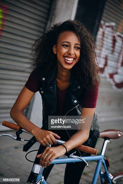 African American girl on a city street with her bicycle