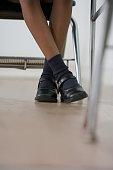 African American girl's legs in classroom
