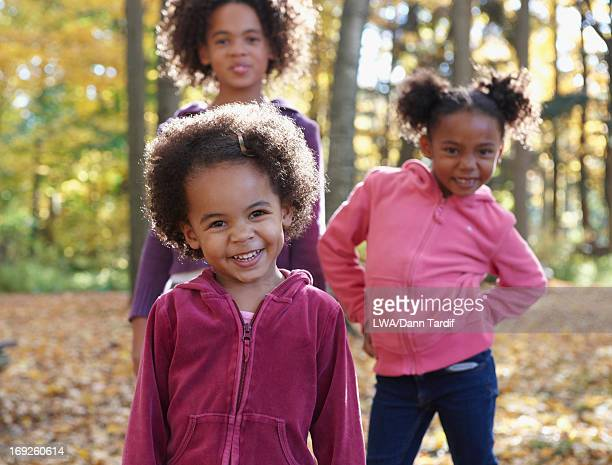 African American girls walking in forest