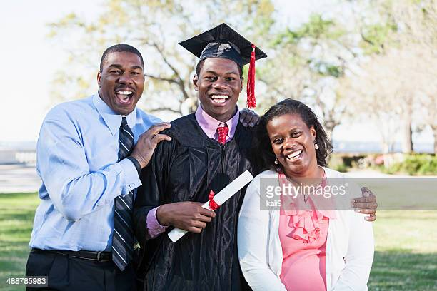 African American graduate with proud parents