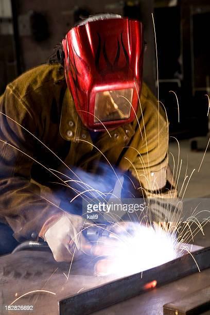 African American industrial worker welding