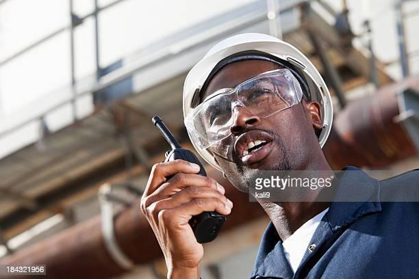 African American industrial worker with walkie-talkie